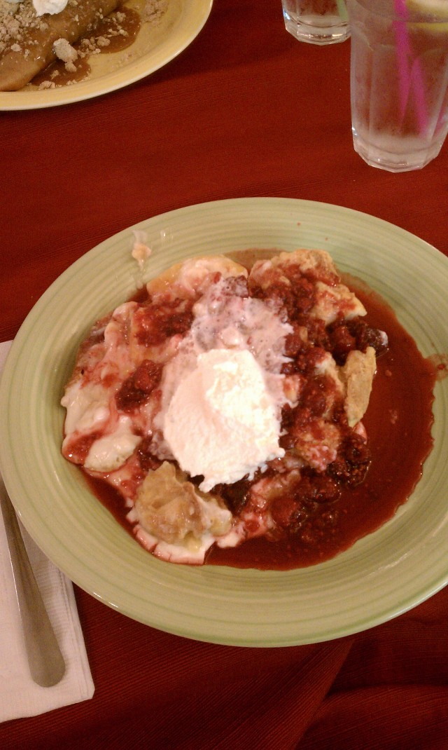 Peach french toast casserole with raspberry sauce and whipped cream. NOMS.
