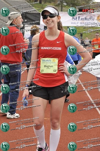 Stoked at the finish line. Moments before I'd been making a pukey face but then I noticed the photographer.